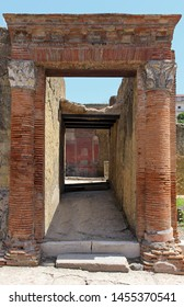 Old architecture tunnel entrance with red brick columns from Roman Empire time