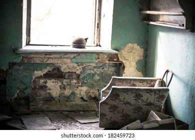 Old armchair in abandoned room