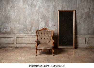 old armchair against a vintage wall