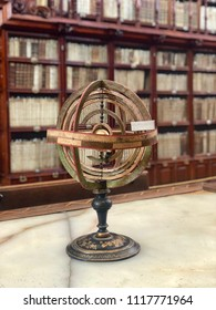 An old armillary sphere - a model of objects in the sky used in astronomy. It consists of a spherical framework of rings, centered on Earth or the Sun.