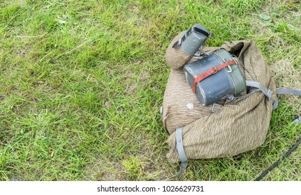 Old army backpack with drinking bottle and metal food container