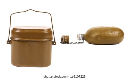 Old army canteen and green mess-tin. Isolated on a white background.