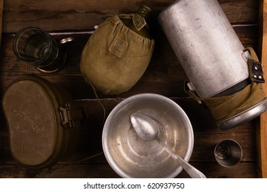 Old army crockery on a wooden background