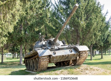 Old army tank on the grassy surface shoot from the distance and exposed in the Memorial center in city of Vukovar