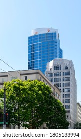 An old art deco high-rise building in contrast to a modern one in downtown Seattle, Washington.