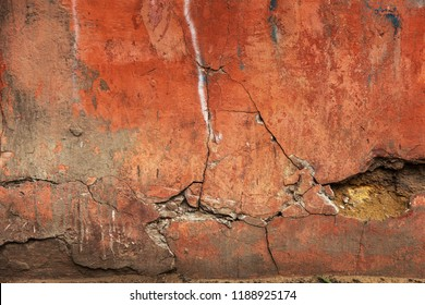 old art texture of plaster brick wall. Painted bad scratched surface in fissures of painted stucco of stone brick wall with petal texture. rubbed facade of building with damaged plaster background