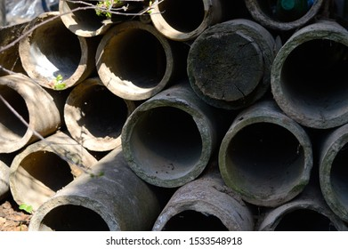 old asbestos pipes stacked in a pile