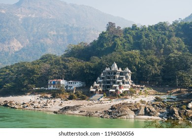 Old Ashram on the Bank of the Ganges river. An ancient temple on a mountainside in the Himalayas. Rishikesh India. The world capital of yoga.