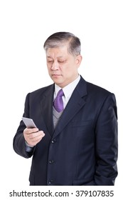 old Asian businessman in suit with mobilephone