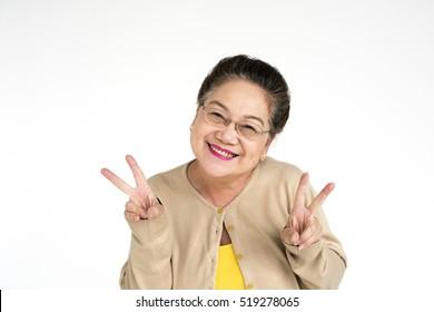 Old asian lady doing the peace sign portrait