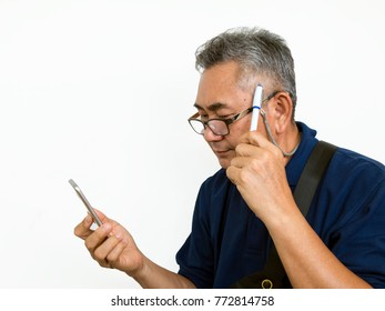 Old Asian man look at mobile phone and think something