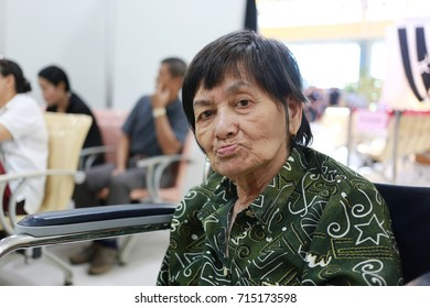 Old Asian woman sitting in wheelchair in hospital,concept of health care.