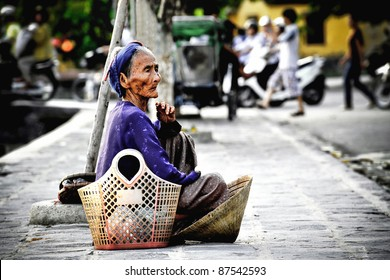 Old asian woman watches what is happening on the street