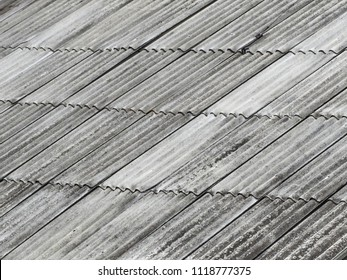 The old assbestos roof. asbestos-cement roofing corrugated sheets.