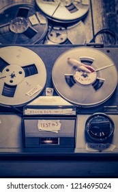 Old audio tape recorder with a few rolls of tape