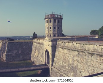 Old Austrian fortress in the Croatian coastal town of Pula in Istria, on a sunny afternoon. Image filtered in faded, retro, Instagram style with soft focus; nostalgic, vintage concept of travel.