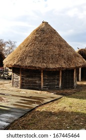 Old authentic village with wooden houses and straw on roof