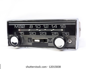 Old auto radio isolated on white. Front view.