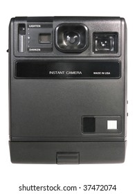 Old automatic instant camera isolated over white background