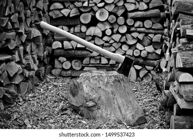 A old axe with fire wood