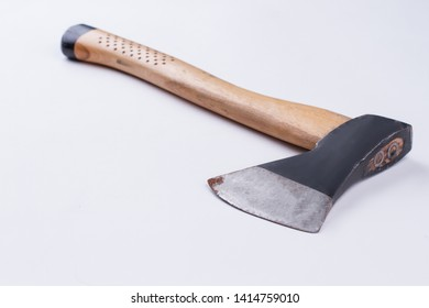 Old axe isolated on white background. Used axe with wooden handle, horizontal image.