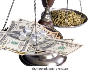 An old balance scale.  Gold nuggets in the rear and US currency and financial dice in the front.  Conceptual image for international finance, money markets, global economy, etc.  Isolated on white.