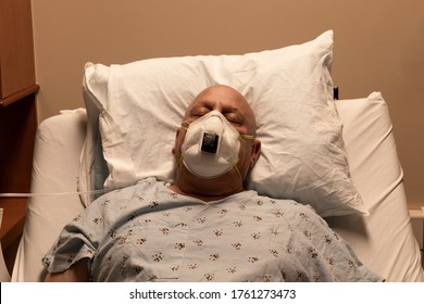Old bald man in a respirator in a hospital bed asleep on a pillow, coronavirus, cancer, chemotherapy, horizontal aspect