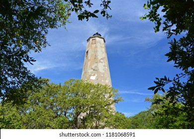 Old Baldy Lighthouse surrounded by trees, Bald Head Island, North Carolina