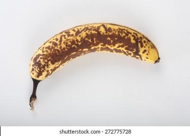 Old banana on white background