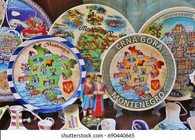 Old Bar, Montenegro - July 13, 2017: Colorful painted plates and spoons showing the map of Montenegro at a souvenir stall in the old city of Bar, Balkan countries, South-East Europe.