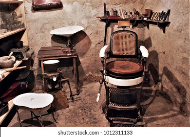 old barber shop with barber chair,antique utensils and barber tools with basins, hair washers, hair clippers,Galician ethnographic museum,old hairdresser's tools