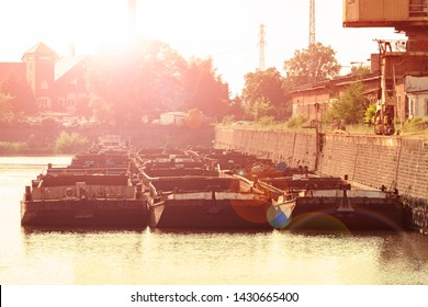 Old barges moored in port. transportation of coal for thermal power plants. Barges waiting to load away