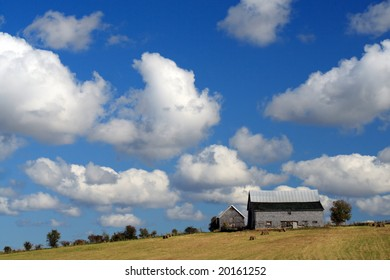 Old Barn and blue sky with clouds