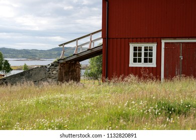 Old barn with bridge in a summer landscape