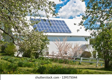 An old barn is brought up to date with solar panels on this Vermont farm.