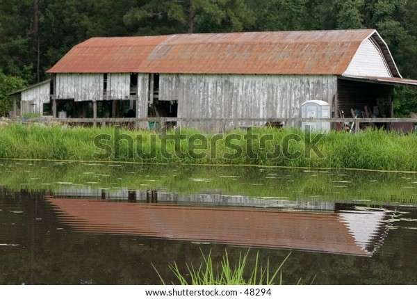 Old Barn by Pond