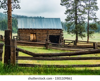 Old barn constructed of hand-hewn timbers on ranch in the mountains