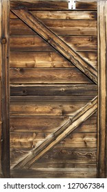 Old barn door wood textured with slanted braces