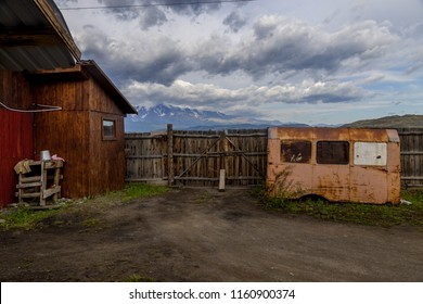old barn on the background of the mountains