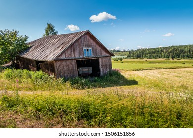 Old barn on the edge of a field.
