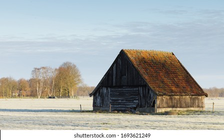 Old barn on a freezing col morning
