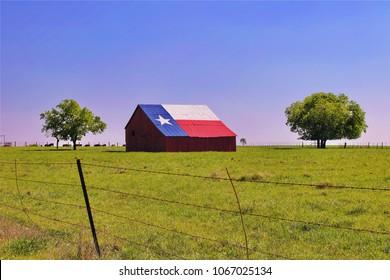 An old barn painted with a Texas Flag near Waco Texas