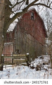 Old barn with red paint peeling, in the snows of Western New York.