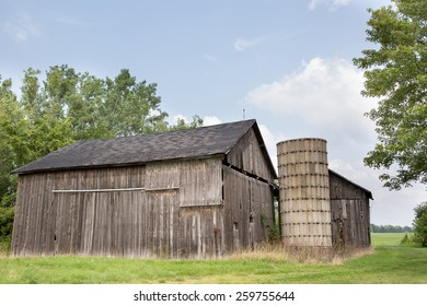 Old barn and silo with a blue sky.