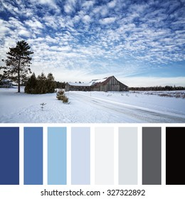 Old barn in the snow, Beauce, Quebec Province, Canada.  In a color palette with complimentary color swatches.