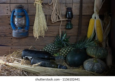 In the old barn which has pile of straw on the floor and dim light /Select focus and still life image