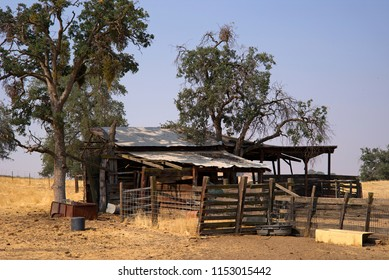 An old barn, yard and corral are still in use on a California mountain ranch.