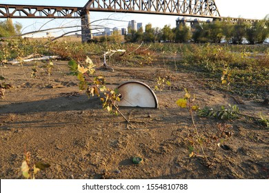 Old barrel buried in the sandy river bed