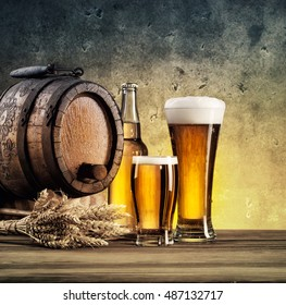 Old barrels and beer glasses tinted in yellow and blue