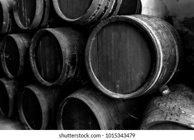 Old barrels for whiskey in black and white